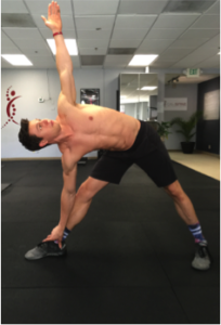 standing triangle stretch for the quadratus lumborum